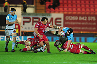 PJ Van Lill of Bayonne is tackled by Jac Morgan of Scarlets during the European Rugby Challenge Cup Round 4 match between the Scarlets and Bayonne at the Parc Y Scarlets in Llanelli, Wales, UK. Saturday 14 December 2019