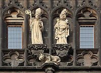 Statues of St Adalbert wearing a mitre and holding a crozier and St Sigismund wearing a crown and holding a sceptre, orb and cross, from the top of the Gothic style Old Town bridge tower at the end of the Charles Bridge or Karluv most, built 1357 - 15th century across the Vltava river in Prague, Czech Republic. Adalbert of Prague, 956-997, was a Czech Roman Catholic saint, a Bishop of Prague and a missionary and patron saint of Bohemia, Poland, Hungary and Prussia. St Sigismund was a patron saint of Bohemia whose relics are held in Prague. The historic centre of Prague was declared a UNESCO World Heritage Site in 1992. Picture by Manuel Cohen
