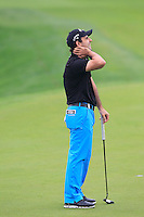 Fabrizio Zanotti (PAR) misses his putt on the 3rd green during Thursday's Round 1 of the 2014 BMW Masters held at Lake Malaren, Shanghai, China 30th October 2014.<br /> Picture: Eoin Clarke www.golffile.ie