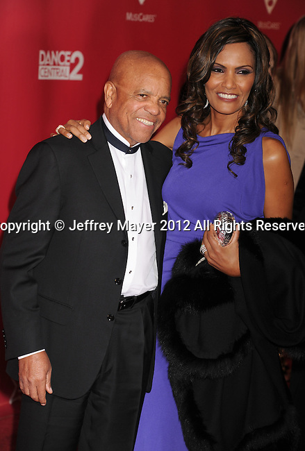 LOS ANGELES, CA - FEBRUARY 10: Berry Gordy and guest arrives at The 2012 MusiCares Person of The Year Gala Honoring Paul McCartney at Los Angeles Convention Center on February 10, 2012 in Los Angeles, California.