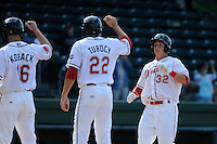 Third baseman Kevin Mager (32) of the Greenville Drive, right, is congratulated by Cody Koback (16) and Drew Turocy (22) after hitting his first professional home run in a game against the Delmarva Shorebirds on Monday, April 29, 2013, at Fluor Field at the West End in Greenville, South Carolina. Delmarva won, 6-5 in game one of a doubleheader. (Tom Priddy/Four Seam Images)