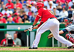 26 September 2010: Washington Nationals pitcher Livan Hernandez attempts a bunt against the Atlanta Braves at Nationals Park in Washington, DC. The Nationals defeated the pennant-seeking Braves 4-2 to take the rubber match of their 3-game series. Mandatory Credit: Ed Wolfstein Photo