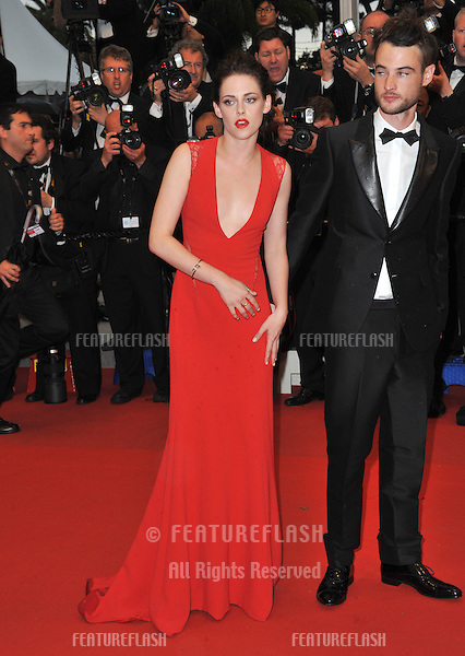 "Kristen Stewart & Tom Sturridge at the gala screening of ""Cosmopolis"" in competition at the 65th Festival de Cannes..May 25, 2012  Cannes, France.Picture: Paul Smith / Featureflash"
