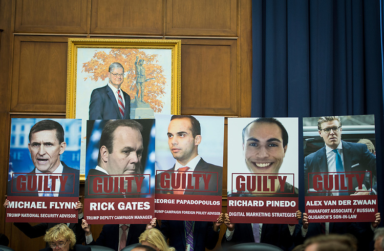UNITED STATES – July 12: Posters depicting the men who have pleaded guilty in Special Counsel Robert Mueller's probe are displayed alongside Rep. Elijah Cummings, D-Md., as he gives his opening statement before FBI Deputy Assistant Director Peter Strzok testifies in front of the House Judiciary Committee and House Oversight and Government Reform Committee during a joint hearing on, 'Oversight of FBI and DOJ Actions Surrounding the 2016 Election' Thursday July 12, 2018.  (Photo By Sarah Silbiger/CQ Roll Call)
