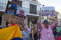 "Demonstrators  supports President Maduro holds a poster entitle ""8089320 votes and I am Pinochet pupil""."