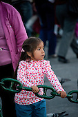 Arequipa, Peru. Young child (Peruvian) holds onto large chain in public park. No MR. ID: AL-peru.