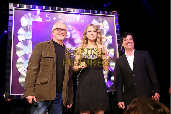 TAYLOR SWIFT.Big Machine label head Scott Borchetta presented Taylor Swift with a plaque commemorating 10 million in sales at Music City Jam during the 2010 Country Radio Seminar (CRS) held at the Nashville Convention Center, Nashville, TN, USA..February 24th, 2010.half length black dress tassels fringed hand thumb up.CAP/ADM/RR.©Randi Radcliff/AdMedia/Capital Pictures.
