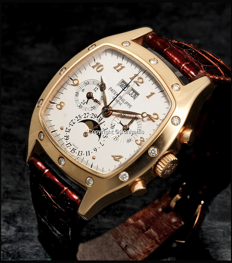 BNPS.co.uk (01202 558833)<br /> Pic: Bonhams/BNPS<br /> <br /> Baron van Wassenaer's favourite - a Patek Philippe 5020R worth £30,000. The 18-karat rose gold timepiece, one of 37 Patek Philippes in his impressive set, has 12 diamonds placed in the case around the watchface, which actually devalue the item.<br /> <br /> An incredible £2million collection of 2,200 watches amassed by one man over six decades is causing a stir in the world of horology as it goes up for auction.<br /> <br /> Dutch nobleman Jan Willem Frederik Baron van Wassenaer had watches spanning more than a century and made by manufacturers for every letter in the alphabet.<br /> <br /> The collection is believed to be the largest ever seen in Europe and is so big it has been split across multiple auctions throughout 2016.<br /> <br /> Fifty important lots from his collection are to be sold by Bonhams in London on June 22 and are expected to fetch £358,000.