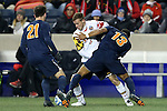 13 December 2013: Maryland's Michael Sauers (3) is defended by Virginia's Kyler Sullivan (13) and Ryan Zinkhan (21). The University of Maryland Terripans played the University of Virginia Cavaliers at PPL Park in Chester, Pennsylvania in a 2013 NCAA Division I Men's College Cup semifinal match. Maryland won the game 2-1.