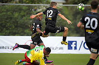 Team Wellington's Andy Bevin flies after the ball during the 2018 OFC Champions League Quarterfinal between Team Wellington and Lae City Dwellers FC at David Farrington Park in Wellington, New Zealand on Saturday, 7 April 2018. Photo: Dave Lintott / lintottphoto.co.nz
