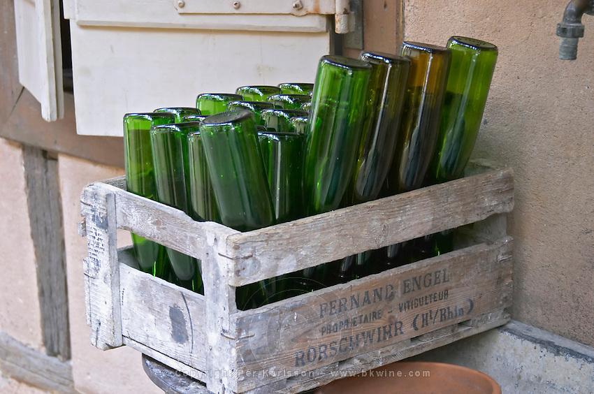 bottles upside down to dry dom bruno sorg eguisheim alsace france