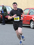 Liam Smith taking part in the Ferdia 5k run in Ardee. Photo: Colin Bell/pressphotos.ie