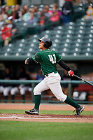 Great Lakes Loons first baseman Luis Paz (41) follows through on a swing during a game against the Burlington Bees on May 4, 2017 at Dow Diamond in Midland, Michigan.  Great Lakes defeated Burlington 2-1.  (Mike Janes/Four Seam Images)