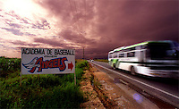 A sign along the Santa Domingo highway show the location of the well-known Baseball Academy for the Anaheim Angels baseball team.