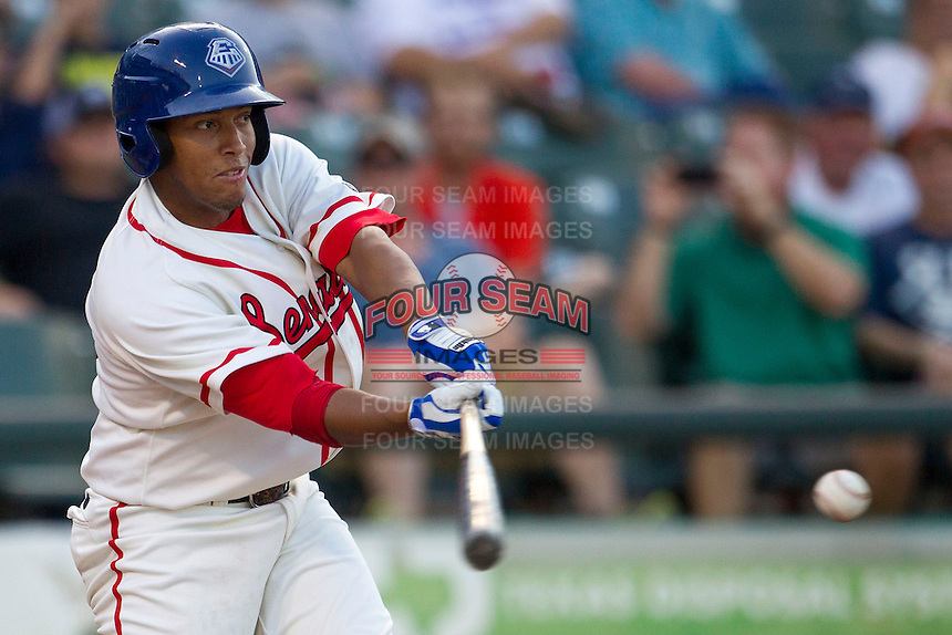 Wearing an Austin Senators throwback uniform, Round Rock Express shortstop Yangervis Solarte (26) swings the bat during the Pacific Coast League baseball game against the Oklahoma City RedHawks on July 9, 2013 at the Dell Diamond in Round Rock, Texas. Round Rock defeated Oklahoma City 11-8. (Andrew Woolley/Four Seam Images)
