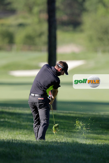 Scott Jamieson (SCO) plays his 2nd shot from the rough on the 3rd hole during Friday's Round 2 of the 2014 Open de Espana held at the PGA Catalunya Resort, Girona, Spain. Wednesday 16th May 2014.<br /> Picture: Eoin Clarke www.golffile.ie