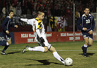 Casey Townsend #11 of the University of Maryland blasts a shot at Matt Smallwood #22 of Penn State during an NCAA 3rd. round match at Ludwig Field, University of Maryland, College Park, Maryland on November 28 2010.Maryland won 1-0.