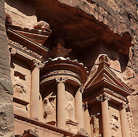 Circular tholos on upper storey, Treasury of the Pharaohs or Khazneh Firaoun, 100 BC - 200 AD, Petra, Ma'an, Jordan. Originally built as a royal tomb, the treasury is so called after a belief that pirates hid their treasure in an urn held here. Carved into the rock face opposite the end of the Siq, the 40m high treasury has a Hellenistic facade with three bare inner rooms. Petra was the capital and royal city of the Nabateans, Arabic desert nomads. Picture by Manuel Cohen