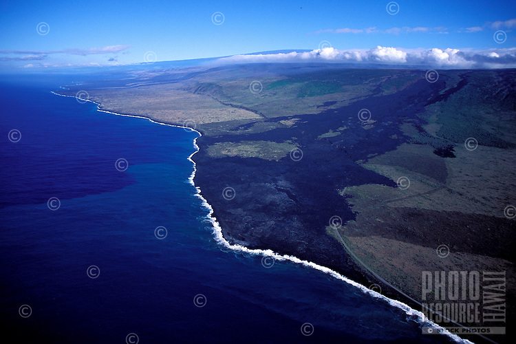 Aerial of an active lava flow over the coastal plain, Kamoamoa coast, Puna