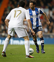 24.03.2012 SPAIN -  La Liga matchday 30th  match played between Real Madrid CF vs Real Sociedad (5-1) at Santiago Bernabeu stadium. The picture show Alvaro Arbeloa Coca (Spanish defender of Real Madrid) and Alberto De la Bella Madueno (Defender Real Sociedad)