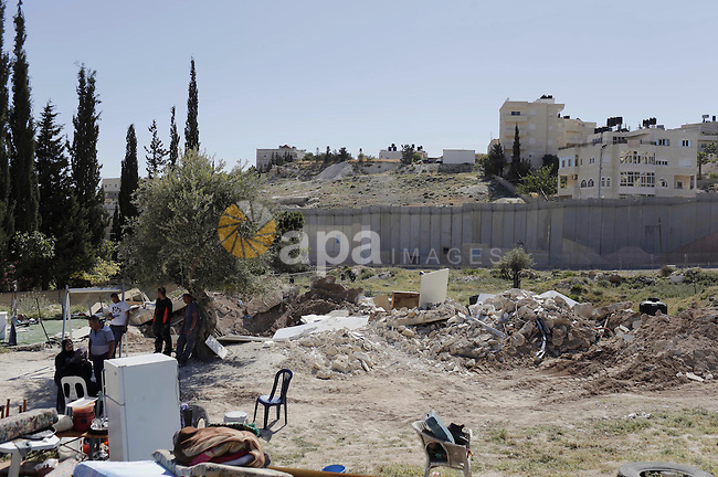 The remains of a Palestinian shed is seen following demolished by Israeli bulldozers, in al-Tur neighborhood, east Jerusalem on April 29, 2014. Israeli forces accompanied by bulldozers, stormed Al-Hardub neighborhood at al-Tur neighborhood in Jerusalem, and proceeded to demolish two residential sheds which housed eight family members, leaving them without a home. Two youths were arrested during the demolition of the sheds. Photo by Saeed Qaq
