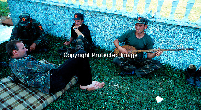KLA soldiers relaxing at a base outside Djakovica, Kosovo in late June 1999. .Photo: Per-Anders Pettersson (ppettersso@aol.com)