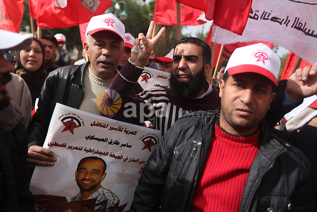 Supporters of the Popular Front for the Liberation of Palestine (PFLP) chant slogans during a demonstration in support of Palestinian prisoners held in Israeli jails, some of whom are observing a hunger strike, in Gaza city on December 20, 2012. Photo by Majdi Fathi