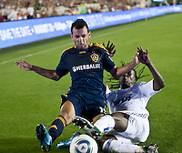 Galaxy midfielder Juninho (19) battles Real midfielder Royston Ricky Drenthe (15) during the first half of the friendly game between LA Galaxy and Real Madrid at the Rose Bowl in Pasadena, CA, on August 7, 2010. LA Galaxy 2, Real Madrid 3.