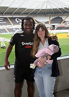 Pictured: Swansea City FC footballer Jason Scotland (L) with a local couple. The labour of the wife started when Scotland scored a goal during a recent game at Libery Stadium, Swansea. South Wales. Thursday 04 December 2008.<br />
