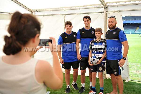 Dan Frost, Adam Hastings and Tom Dunn pose for a photo with a Bath Rugby supporter. Bath Rugby Family Festival of Rugby, on August 8, 2015 at the Recreation Ground in Bath, England. Photo by: Patrick Khachfe / Onside Images