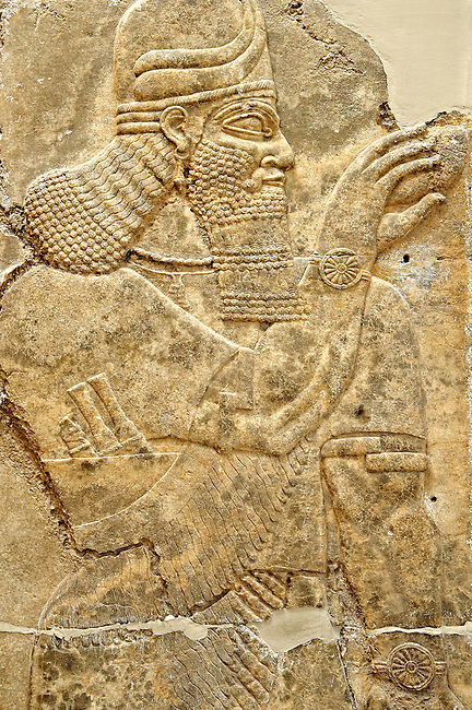 Chaldean Assyrian relief sculpture slab from the northwest palace of King Ashurnasirpal II of a Genie standing. 881-859 B.C form Nimrud or Nimrut ( Kalhu or Kalah). Istanbul Archaeological exhibit Inv. No. 6.