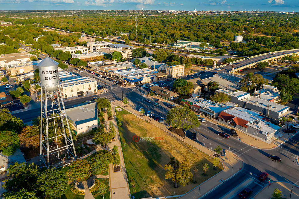 Aerial view of the iconic Round Rock water tower was originally built in 1935 by the Pittsburgh-Des Moines Steel Company. The 50,000-gallon, riveted steel tank standing at around 140 feet and has served as an iconic symbol of historic downtown Round Rock.