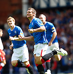 Lee McCulloch races off to celebrate his goal