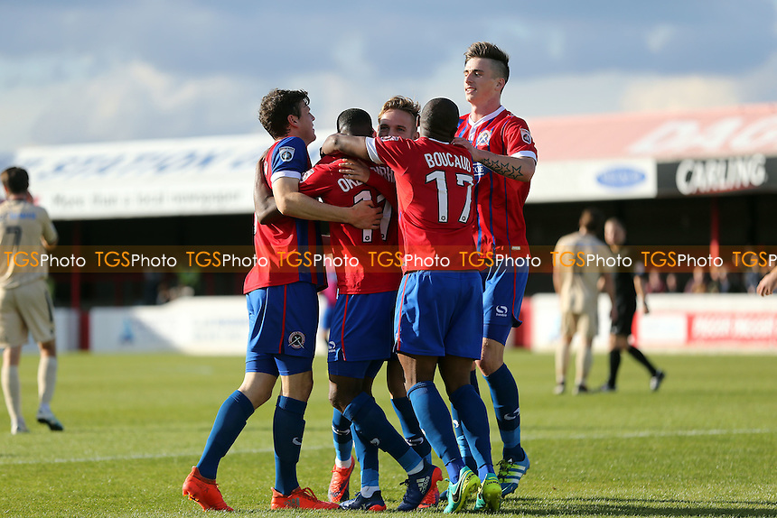 Fejiri Okenabirhie of Dagenham is congratulated after scoring the opening goal during Dagenham & Redbridge vs Wealdstone , Emirates FA Cup 4th Qualifying Round Football at the Chigwell Construction Stadium on 15th October 2016