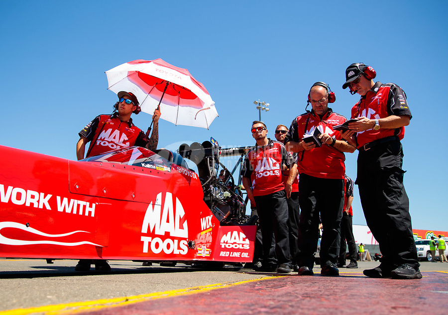 Jul 27, 2019; Sonoma, CA, USA; Crew members stand alongside the dragster of NHRA top fuel driver Doug Kalitta during qualifying for the Sonoma Nationals at Sonoma Raceway. Mandatory Credit: Mark J. Rebilas-USA TODAY Sports