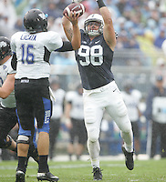 State College, PA - 09/12/2015:  DT Anthony Zettel (98) hurries Buffalo QB Joe Licata, resulting in an interception for DE Carl Nassib of the Nittany Lions. Penn State defeated Buffalo by a score of 27-14 at rainy Beaver Stadium in University Park, PA.<br /> <br /> Photos by Joe Rokita / JoeRokita.com