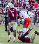 Florida State's Levanta Taylor, left, and Tarvarus McFadden celebrate after Syracuse kicker Cole Murphy missed a field goal to tie the game with six seconds left giving Florida State a 27-24 victory in an NCAA college football game in Tallahassee, Fla., Saturday, Nov. 4, 2017.  (AP Photo/Mark Wallheiser)