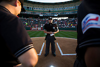 Home Plate Umpire Alberto Ruiz, center, stands at home plate prior to a game between the Northwest Arkansas Naturals and Springfield Cardinals at Hammons Field on August 20, 2013 in Springfield, Missouri. (David Welker/Four Seam Images)
