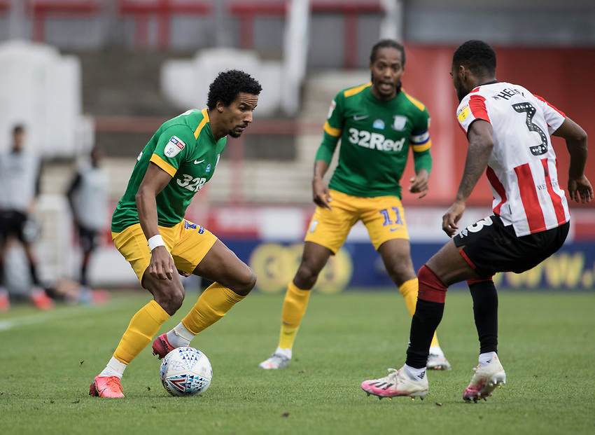 Preston North End's Scott Sinclair competing with Brentford's Rico Henry (right) <br /> <br /> Photographer Andrew Kearns/CameraSport<br /> <br /> The EFL Sky Bet Championship - Brentford v Preston North End - Wednesday 15th July 2020 - Griffin Park - Brentford <br /> <br /> World Copyright © 2020 CameraSport. All rights reserved. 43 Linden Ave. Countesthorpe. Leicester. England. LE8 5PG - Tel: +44 (0) 116 277 4147 - admin@camerasport.com - www.camerasport.com