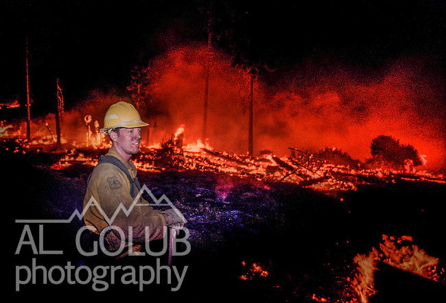 August 19, 1996 Sonora, California  -- Rogge Fire – Stanislaus National Forest firefighter Dave Batson from Engine E-42 fights the fire at 1:00 a.m. The Ackerson and Rogge Fires combined to char 60,000 acres in 1996. The Rogge Fire was centered on the north side of the Tuolumne River, burning over Jawbone Ridge and Cherry Creek areas.
