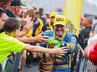 Oct 14, 2018; Concord, NC, USA; NHRA funny car driver Ron Capps celebrates after winning the Carolina Nationals at zMax Dragway. Mandatory Credit: Mark J. Rebilas-USA TODAY Sports