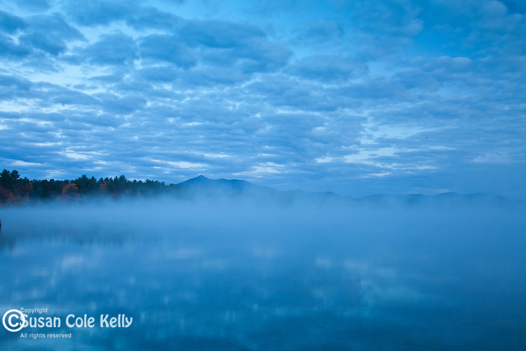 A foggy sunrise on Silver Lake in Madison, NH, USA