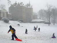 Children enjoy the snow by sledding, Thursday, December 5, 2002 in Doylestown, Pennsylvania. The Philadelphia region was expecting 4-6 inches of snow from it's first major winter storm in two years. (Photo by William Thomas Cain/Cain Images)