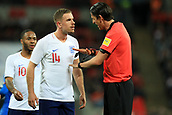 27th March 2018, Wembley Stadium, London, England; International Football Friendly, England versus Italy; Referee Deniz Aytekin tells Jordan Henderson of England there was contact as he awards a penalty via the VAR system