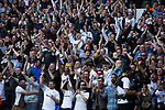 Supporters in the East Stand react with delight as the home team score their second goal as Tottenham Hotspur took on Watford in an English Premier League match at White Hart Lane. Spurs were due to make an announcement in April 2016 regarding when they would move out of their historic home and relocate to Wembley as their new stadium was completed. Spurs won this match 4-0 watched by a crowd of 31,706, a reduced attendance figure due to the ongoing ground redevelopment.