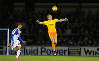Ryan Sellers of Wycombe Wanderers wins the ball in the air from Paris Cowan-Hall of Bristol Rovers during the Sky Bet League 2 rearranged match between Bristol Rovers and Wycombe Wanderers at the Memorial Stadium, Bristol, England on 1 December 2015. Photo by Andy Rowland.