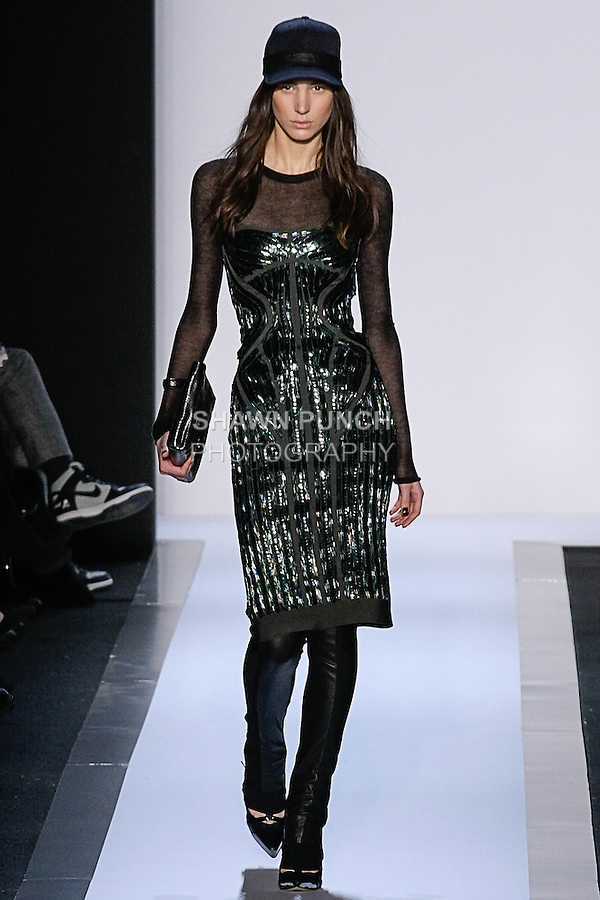 Model walks runway in an outfit from the Herve Leger by Max Azria Fall 2013 runway show, during Mercedes-Benz Fashion Week Fall 2013.