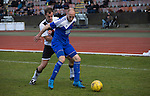 Dougie Gair (left) in second-half action during the Scottish pyramid play-off second leg between Edinburgh City (in white) and Cove Rangers at the Commonwealth Stadium at Meadowbank in Edinburgh. The match between the champions of the Lowland and Highland Leagues determined which club would play-off against East Stirlingshire for a place in the Scottish league. The second leg ended 1-1, giving Edinburgh City a 4-1 aggregate win.