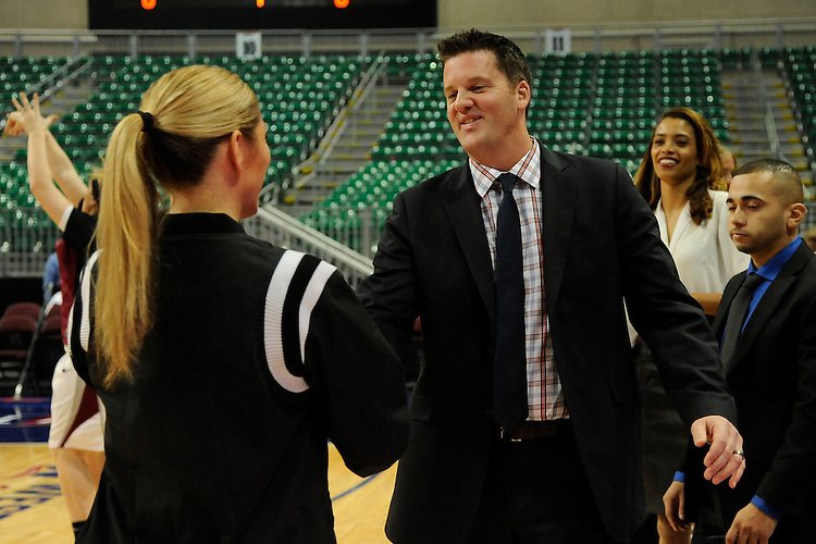 March 6, 2014; Las Vegas, NV, USA; Pepperdine Waves head coach Ryan Weisenberg (right) shakes hands with a referee against the Santa Clara Broncos before the game of the WCC Basketball Championships at Orleans Arena. The Waves defeated the Broncos 80-74.