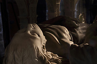 Effigy of Anne of Brittany, detail from the funerary monument of Louis XII, 1462-1515, and Anne of Brittany, 1477-1514, made 1516-31 in Carrara marble by Giovani di Giusto Betti, 1479-1519, in the Basilique Saint-Denis, Paris, France. The mausoleum resembles an antique temple and is surrounded by the 12 apostles and the 4 cardinal virtues, Prudence, Might, Justice and Temperance and the plinth is decorated with bas-reliefs of the Italian wars. The basilica is a large medieval 12th century Gothic abbey church and burial site of French kings from 10th - 18th centuries. Picture by Manuel Cohen